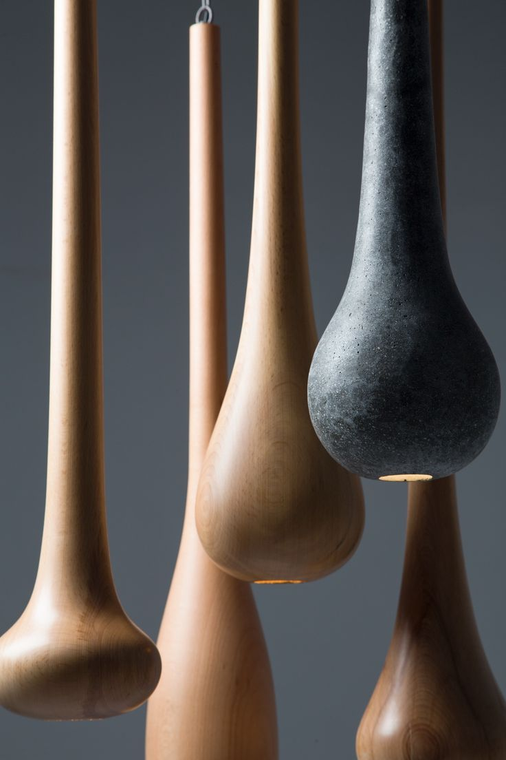 Drop, Tear. Composition of hand made pendant lamps from wood and concrete