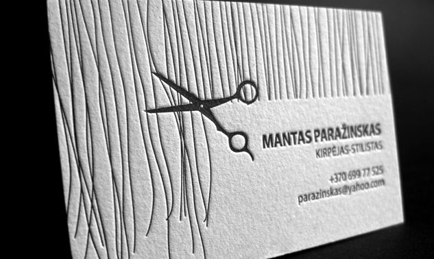 This letterpress business card was designed by Elegante Press.