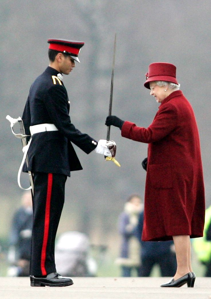 Queen Elizabeth turns 89: her life in photos - Queen Elizabeth II presents the Oversea's Sword award to Junior Under Officer Abu Bakar Bin Abdillah Alkatib of Singapore, during an officer cadets passing parade at Royal Military Academy Sandhurst, England, on Friday, Dec. 15, 2006.