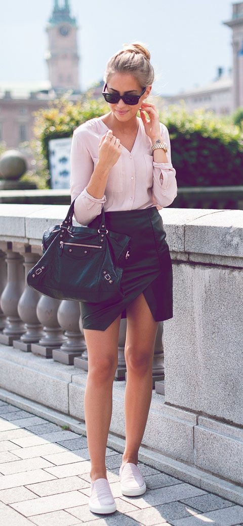 Kenza Zouiten is wearing a black asymmetrical skirt from Lindex, pink shirt from H&M, shoes from Henry Cole and and a bag from Balenciaga