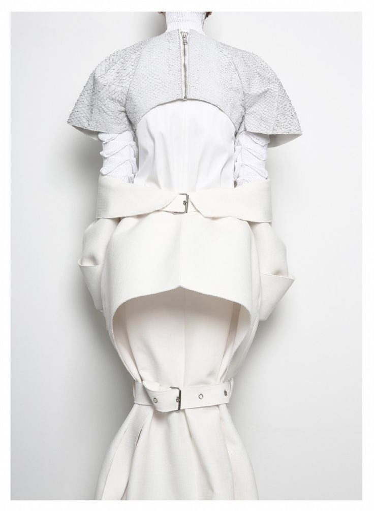Conceptual Fashion Design with a sculptural silhouette, using layers of white + buckles to explore the idea of restriction // Patrik Guggenberger AW14