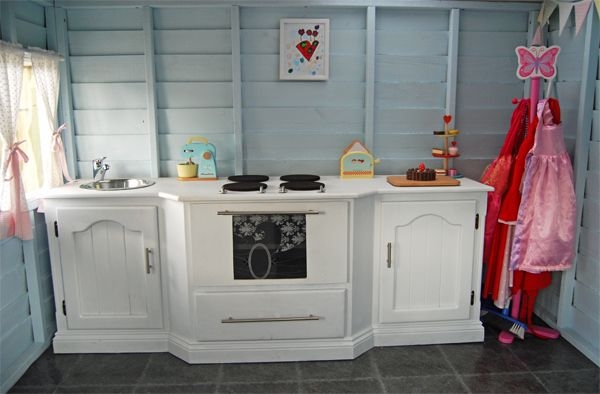 An old TV unit turned into a childs dream play kitchen! #DIY at it's best. #Cubby house is from Aarons Outdoor Living http://www.aaronsoutdoor.com.au/cubby-houses/
