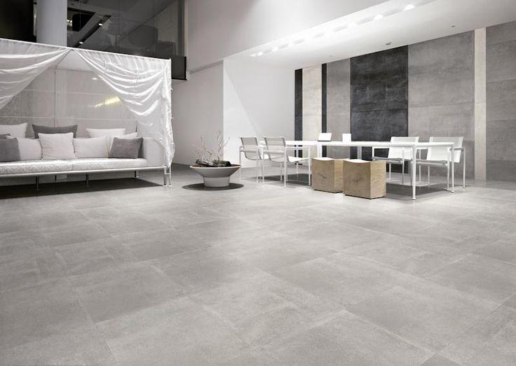Prachtige strakke vloer met grootformaat betonlook tegels