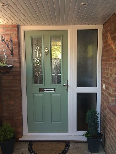 Winstone Windows - Bristol Composite Door in chartwell green with white frames and 2 side panels, Flair design glass, and chrome furnishings