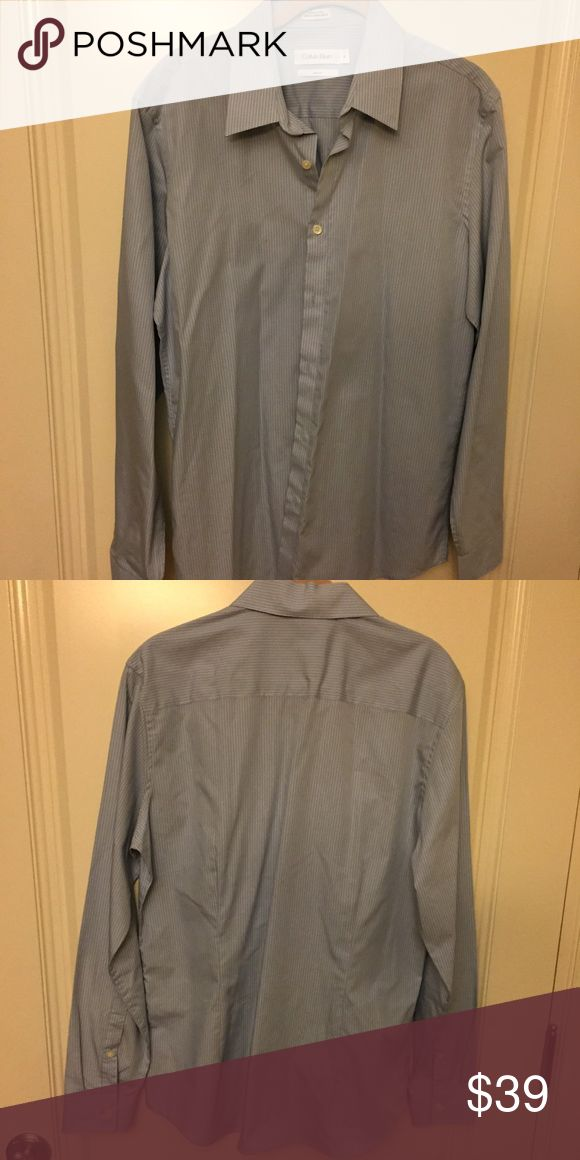 Calvin Klein gray long sleeve Calvin Klein ling sleeve gray button up, men size medium.  Excellent condition Calvin Klein Shirts Casual Button Down Shirts