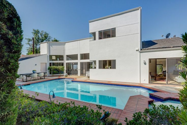Privacy. Architect Tony Ngai, c. 1984. On an untraveled Los Feliz OAKS street, first time on the market. A meteoric entrance defines this exceptional example of the modernization period, where postmodern architecture and fine art slid into bed with each other to create magic. At the end of a cul-de-sac, finds this soaring beautiful 4 Bedrooms, 4 Bath home with separate loft-style office. Private solar heated Pool with spa on main level, newer remodeled chef's kitchen, triple high vaulted ...