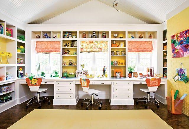 creative studio - love the shelves surrounding the windows.