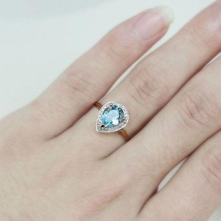 Bague or rose 14 cts , Topaze bleue et diamants.