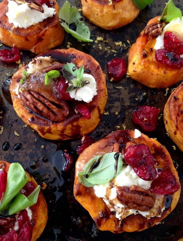 Sweet Potato Rounds Recipe with Goat Cheese, Cranberries & Honey Balsamic Glaze, finished with a blood orange infused olive oil & fresh basil. #Sweet_Potato #Goat_Cheese #Appetizers