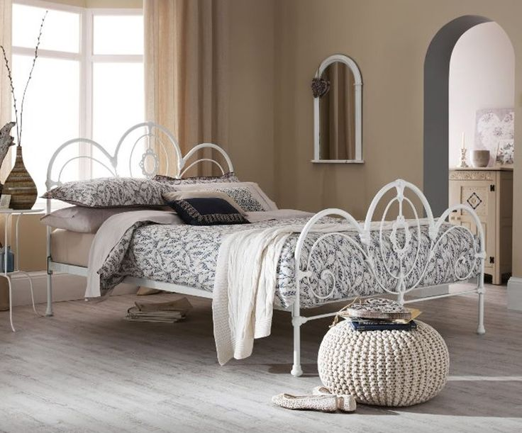 The Harriet bed frame, with gothic influence, features a intricate curved design and is finished in a white gloss. Features high head and foot end designs with elegant curved detailing which helps create a traditional look.