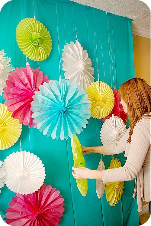 plastic tablecloths and paper fans...cute & colorful...but also can be distracting from the faces which should be the focus of photobooth fun!