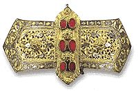 Belt-buckle from Epirus with hammered gilt ornamentation and a silver band of stylized tulips in savati.  Mid-18th century.  Athens Benaki Museum