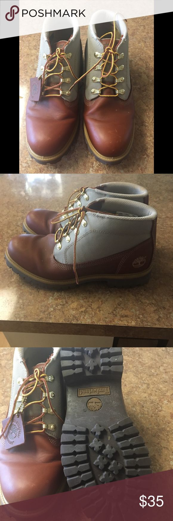 Men's Timberland ankle boots. Leather with canvas around ankle. Excellent condition as they were worn once. Timberland Shoes Boots