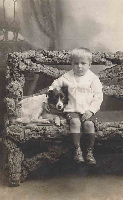 young boy with dog on Rustic bench by Libby Hall Dog Photo, via Flickr