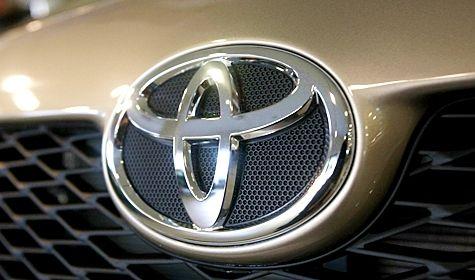 Toyota quarterly profit down on development costs