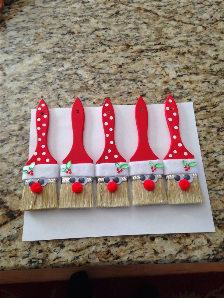 Santa paint brush ornaments... They look so cool I think I am going to make them