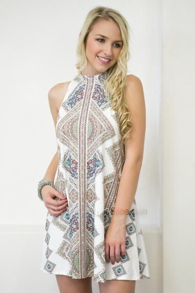 I am so FASCINATED by this white festival dress! When I look at the intricate pattern I feel like I'm lost in a maze of turquoise and moss. This sleeveless dress features a mock neck, a keyhole back,