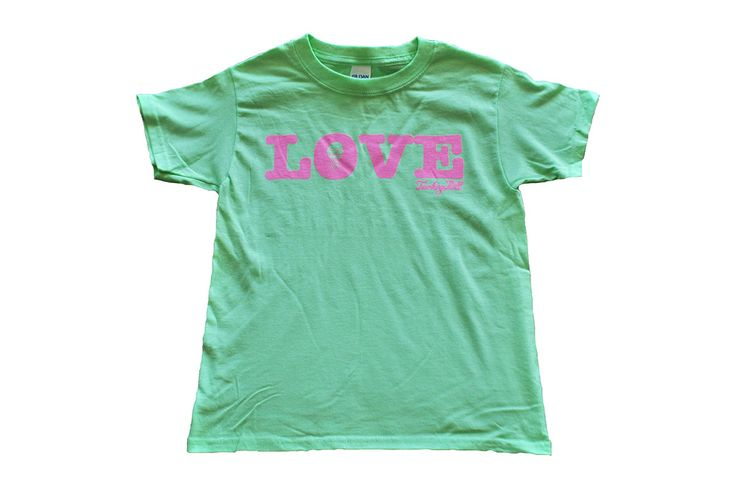 This youth shirt is cute and simple. Bubblegum pink print on a mint green shirt, shirt is 100% cotton.