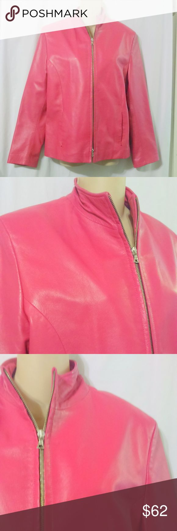"""Moda In Pelle Firenze Hot Pink Leather Jacket This gorgeous leather jacket is made by Moda In Pelle Firenze and is an Italian size 50 or about a size 14 US. The jacket is done in a fully lined hot pink leather that is probably the softest leather I've ever felt. It has a zip front and zip pockets. Measurements are: Bust 42"""", waist 40"""", hips 42"""", sleeves 25"""", length 25"""". The lining does have a stain near the bottom at the back which I've shown in the last picture. Other than that jacket is in…"""