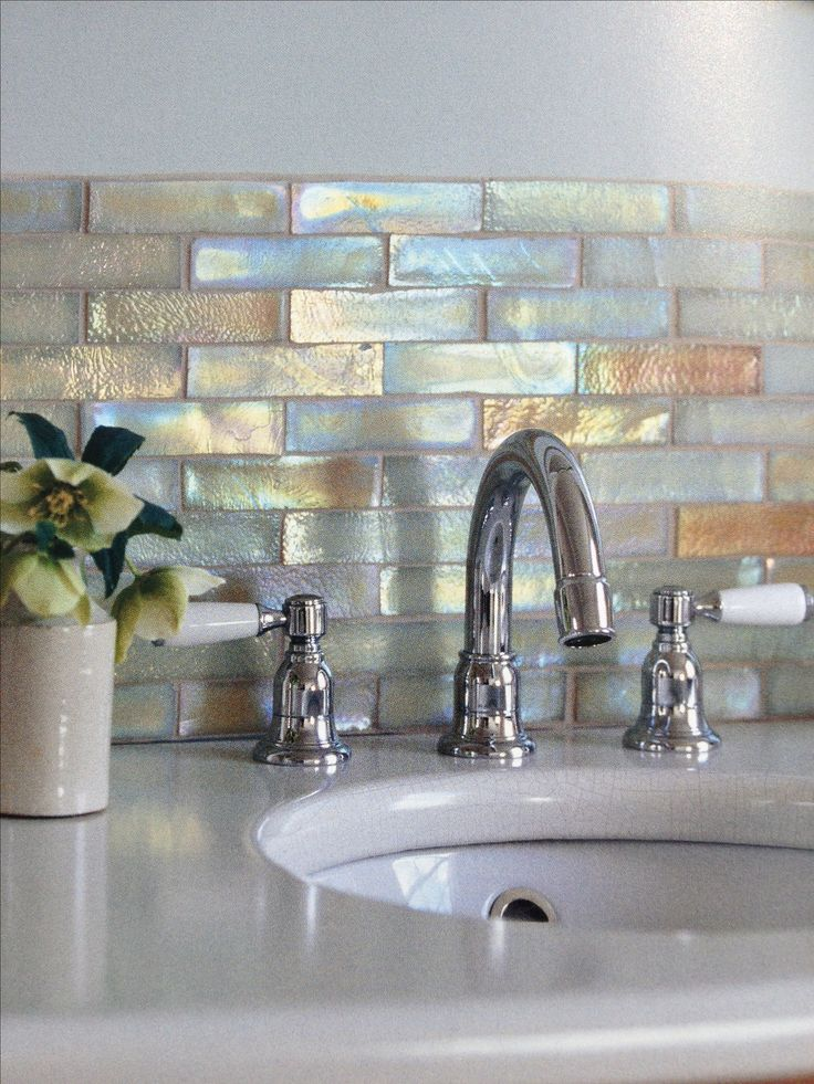 sarah glen ☀ sg Metallic tiles add a touch of personality to your bathroom. | Find more amazing projects and design news in http://bocadolobo.com/blog/