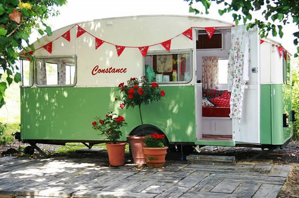 if using old rv for garden shed/tools, why not paint really cute on outside