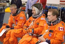 S.M. with 2 NASA astronauts at JSC