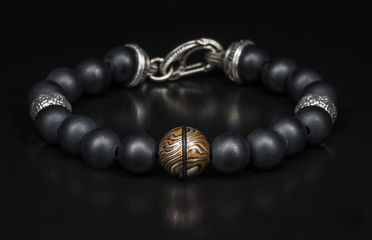 The rugged styling of this William Henry bracelet incorporates frosted onyx, mokume gane, and Sterling Silver.