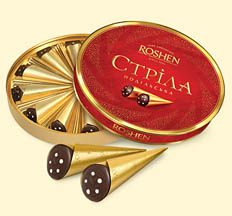 STRILA PODILSKA  Roshen - Fine Chocolate Since 1996.   These beautifully boxed chocolates are cone-shaped, glazed, with cream-cognac filling and individually wrapped in gold foil. An impressive looking gift presentation!