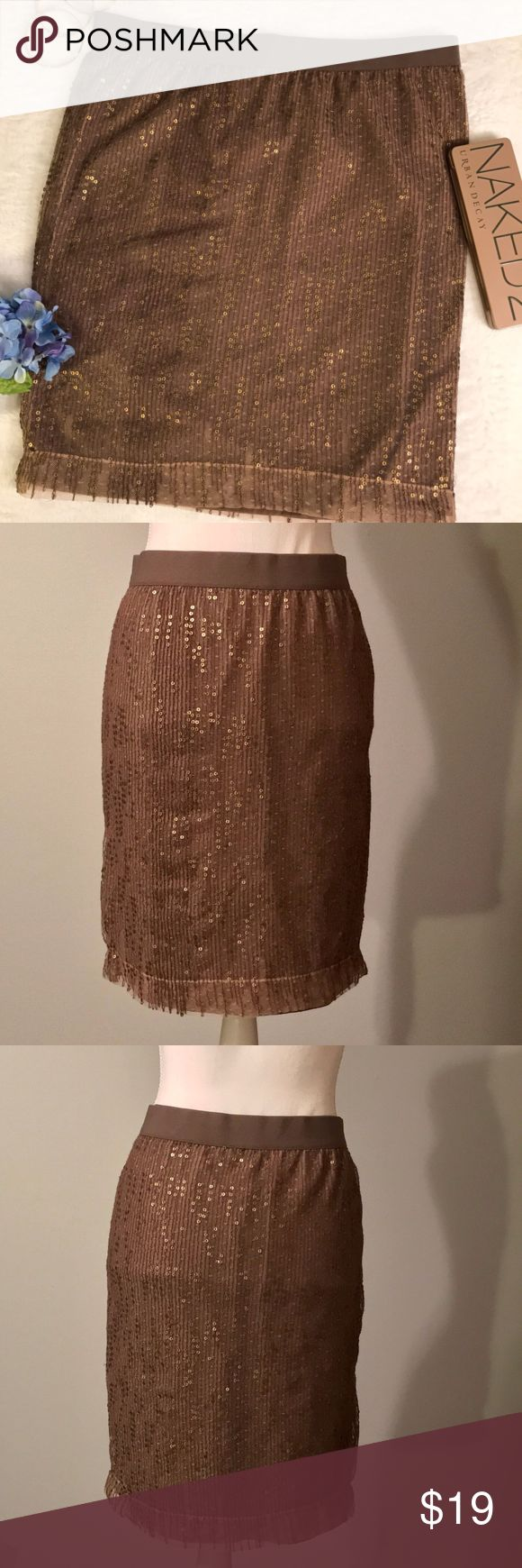 "Gap brown sequin pencil skirt Gap brown sequin pencil skirt. Dark brown pencil skirt. Elastic pull on waist band. Seamless skirt. Brown sheer overlay with gold tone shimmery sequin detail. Dark brown lining. Size 6. EUC, excellent used condition. Measurements taken laid flat. 16"" waist, 21"" length. GAP Skirts Pencil"