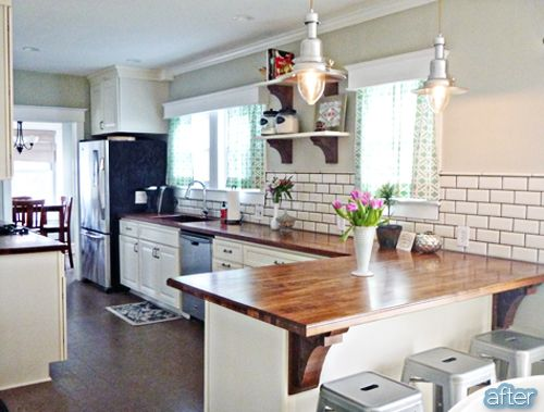Butcher block peninsula in kitchen- I really love the look of butcher block counter tops.. And ...