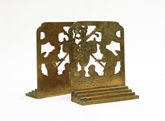 mid-century modern Hollywood Regency brass bookends
