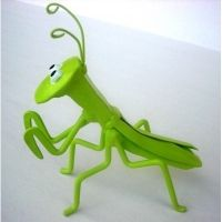 Hand welded and hand painted Praying Mantis garden Critter made from recycled railroad spikes and have a urethane coating for outdoor use.