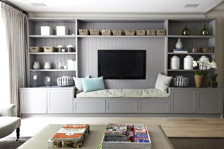 built-in shelving unit with tv and integrated bench seat | tv