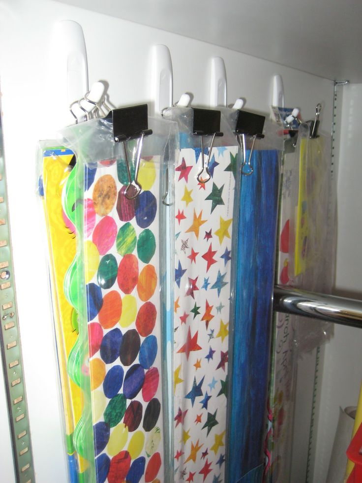 Great idea for organizing borders: use a binder clip to hang sets from 3M hooks.