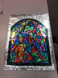 Faux stained glass window using a transparency and aluminum foil