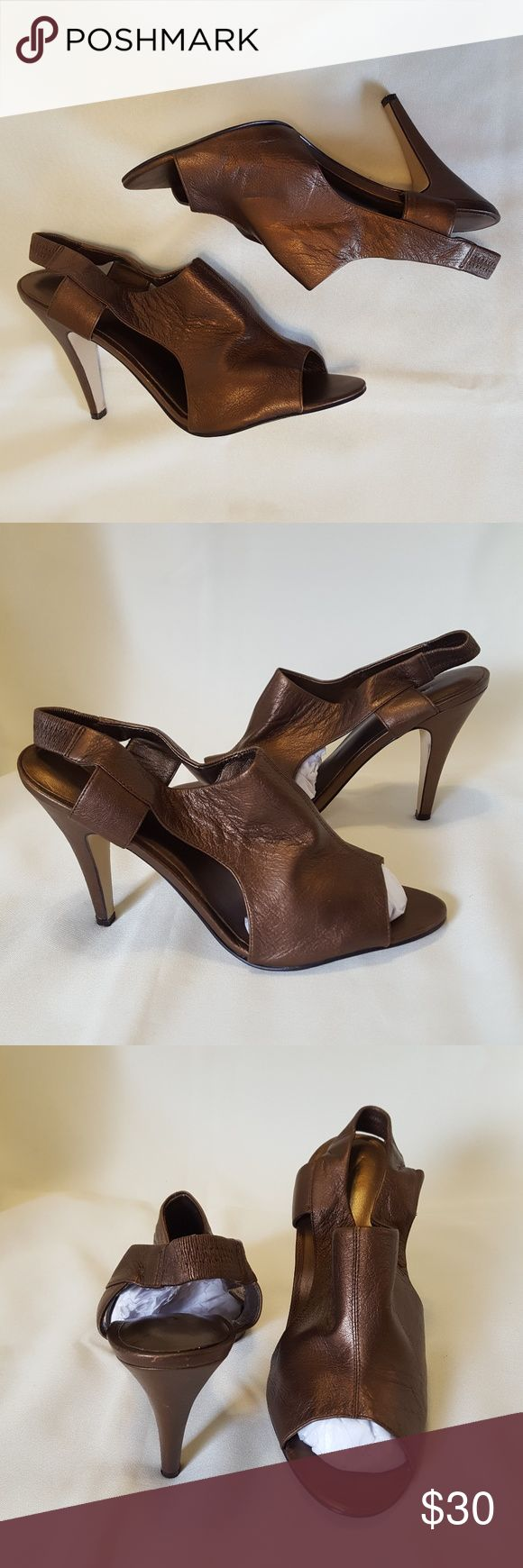 Nine West Bronze Heels Size 8.5. Leather Nine West bronze heels that measure at about 4 inches (see photo 6). There is some wear in the back of the heels (shown in photo 5). The back of the straps are stretchy & comfortable. The smooth leather upper on these sexy heels is a beautiful metallic bronze! Nine West Shoes Heels