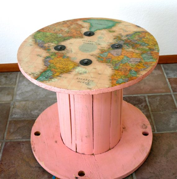 Reclaimed cable spool table with map and lacquer. Perfect for your kid's playroom.