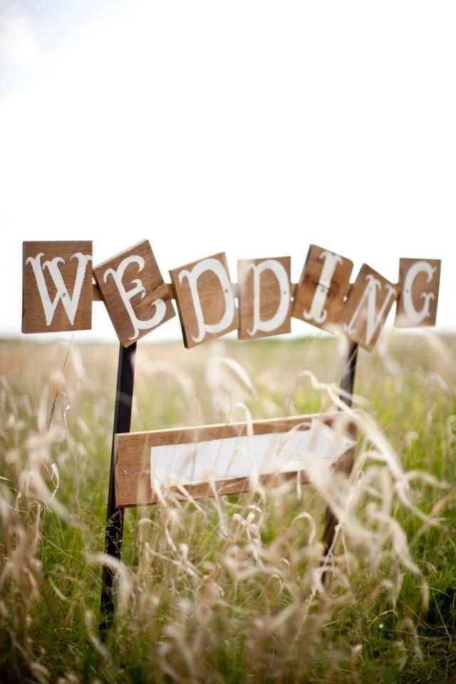Wedding sign in field. Nice touch with the individual letters!
