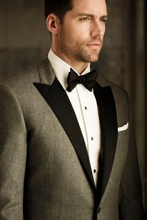 Grooms party In this &a groom in black tux