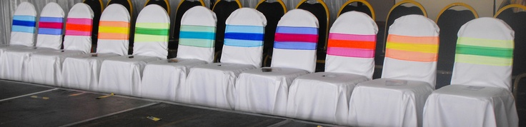 Double Rainbow Coloured Organza Bows on White Chair Covers