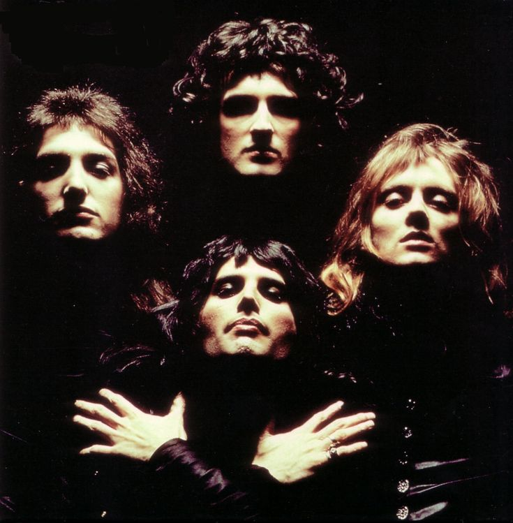 Queen -  Freddie Mercury, Brian May, John Deacon, and Roger Taylor