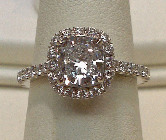 6.5 cts. Cushion diamond halo setting ring platinum. Where can i find this exact ring that's FAKE? I want it.
