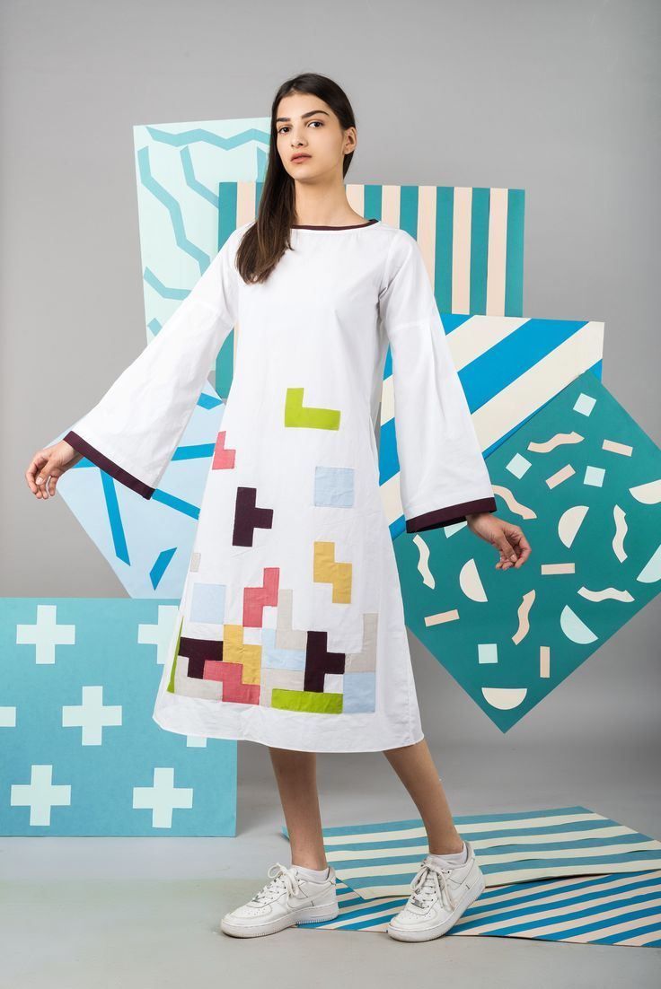 Play Tetris. A line midi with exaggerated bell sleeves and Tetris appliqué patchwork.