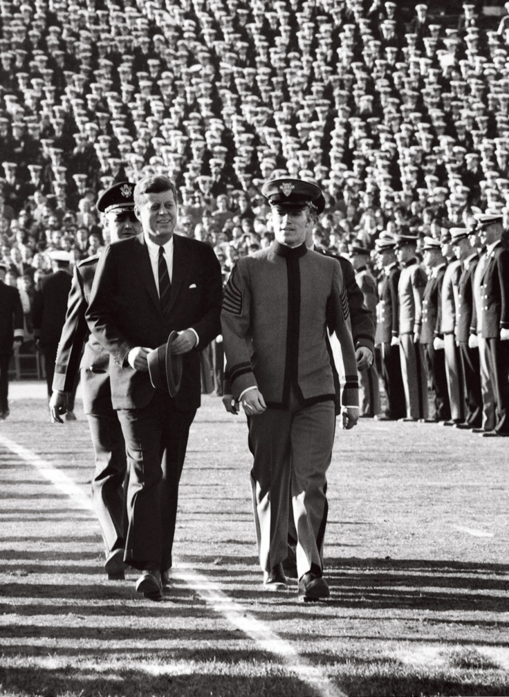 JFK AT ARMY – NAVY GAME United States President John F. Kennedy walks onto the field for the coin toss before the Army – Navy Game at Philadelphia Municipal Stadium. Philadelphia, Pennsylvania 12/1/1962