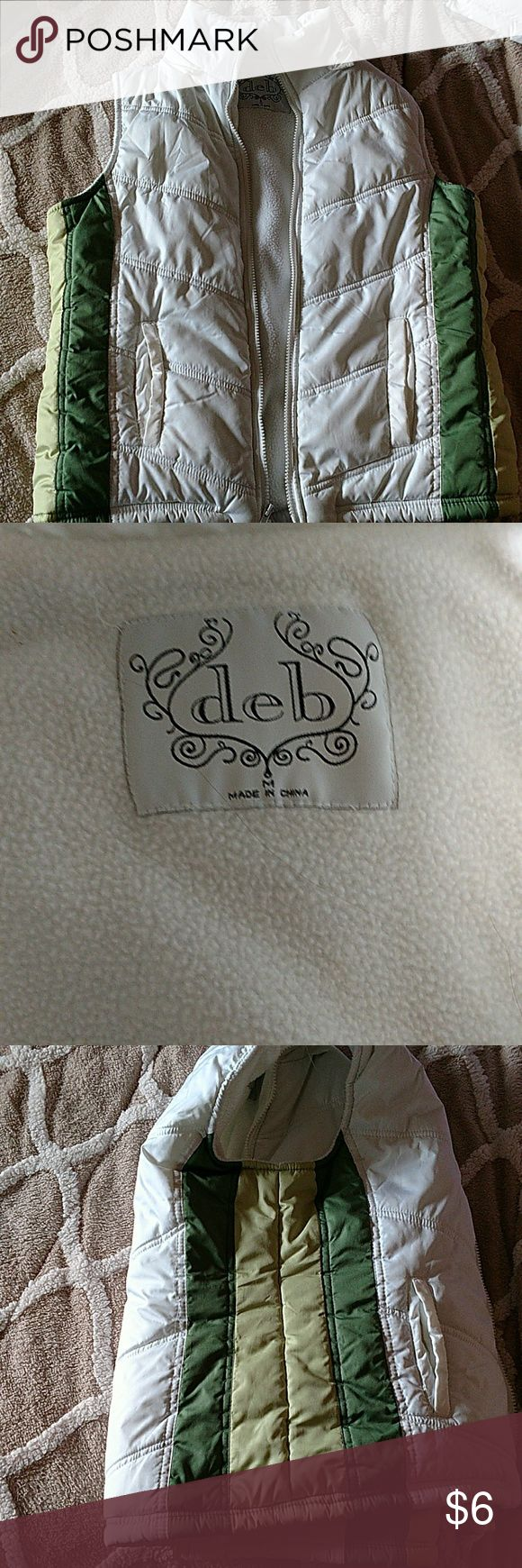 Deb shop vest Women's/Juniors size medium vest from the Deb shop, good condition, looks like a little yellowing near the right pocket also a spot on the left side, please see pics.  There was a hood, I don't have it. Deb Jackets & Coats Vests