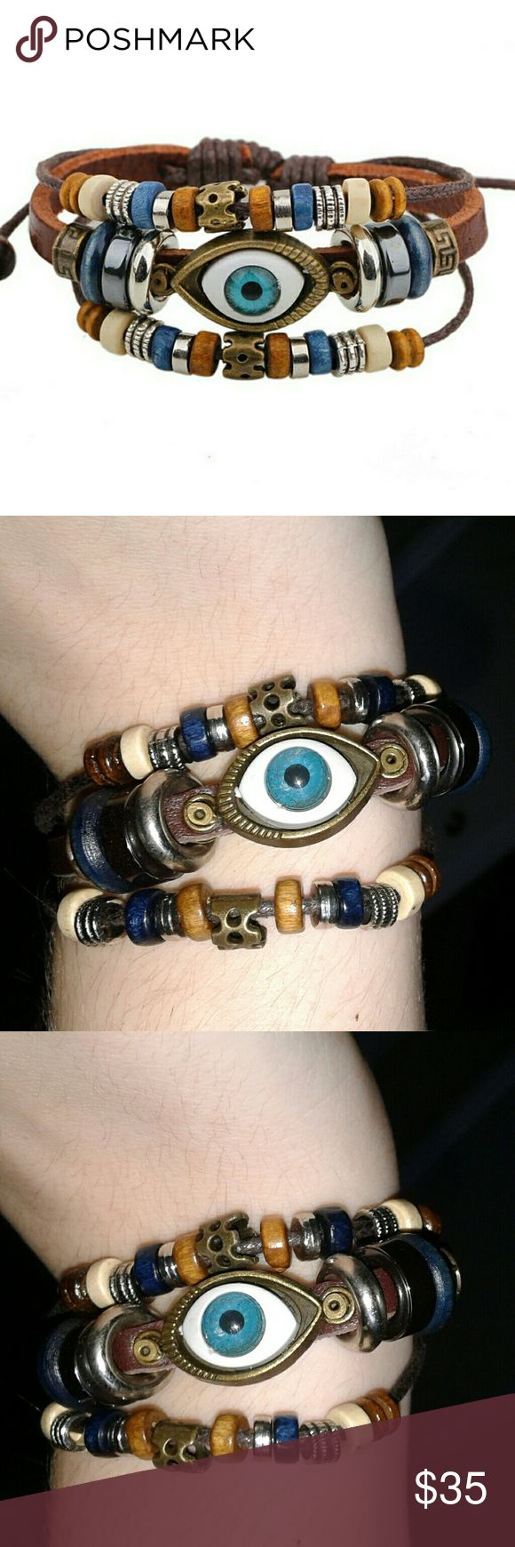 *New* Eye Beaded Bracelet This is 3 bracelets in one and its adjustable via knots in the back. The main part is a fake leather.                                                     Tags- beads, steampunk, hot topic, mystical, mysterious, wood, wooden, metal, eyes, surreal, art, blue, brown. Jewelry Bracelets