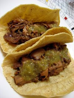 """Jackfruit """"Carnitas"""" Tacos  Ingredients:  Young Green Jackfruit, canned, in brine or water, not syrup.  Salsa Verde (Trader Joe's brand is ideal.)  Lime juice  Onion, cut in to large pieces.  Garlic, pressed or minced.  Chile Powder  Cumin  Pepper  Smoked Paprika  Cayenne Pepper  Oregano"""