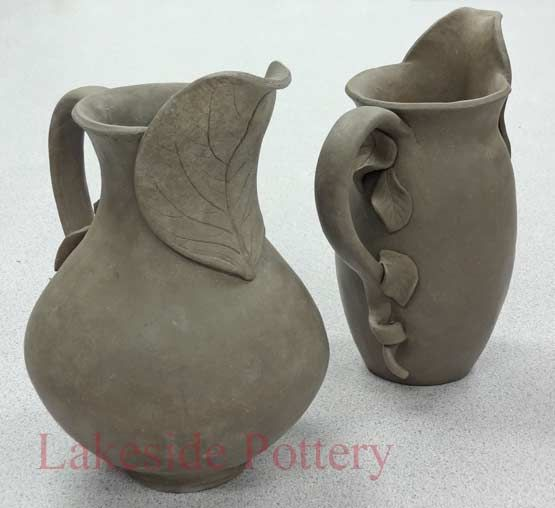 Hand built pitchers with leaves design.These are absolutely gorgeous.