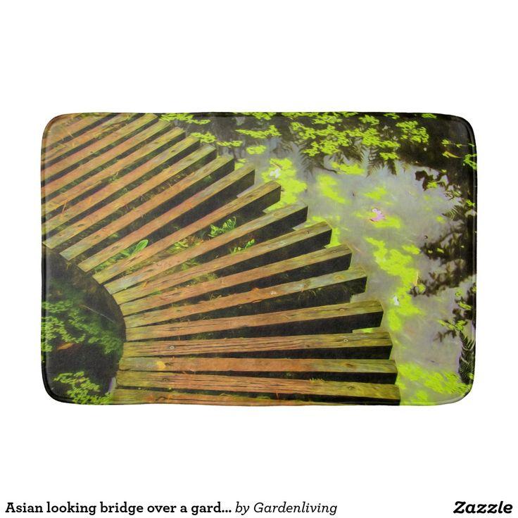 Bath mats. Asian looking bridge over a garden pond.