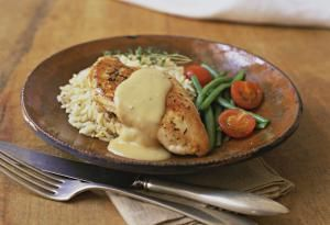 chicken with hollandaise sauce on rice - Melanie Acevedo/Photolibrary/Getty Images